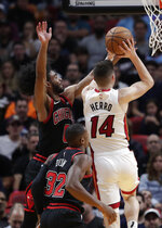 Miami Heat guard Tyler Herro (14) goes to the basket as Chicago Bulls guard Coby White (0) defends during the first half of an NBA basketball game, Sunday, Dec. 8, 2019, in Miami. (AP Photo/Lynne Sladky)