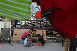 Migrant children play at the AMAR migrant shelter in Nuevo Laredo, Mexico, Wednesday, July 17, 2019. Asylum-seekers grappled to understand what a new U.S. policy that all but eliminates refugee claims by Central Americans and many others meant for their bids to find a better life in America amid a chaos of rumors, confusion and fear. (AP Photo/Marco Ugarte)