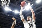 Cincinnati's Jaume Sorolla (35) shoots during the first half of an NCAA college basketball game against East Carolina, Sunday, Jan. 19, 2020, in Cincinnati. (AP Photo/John Minchillo)