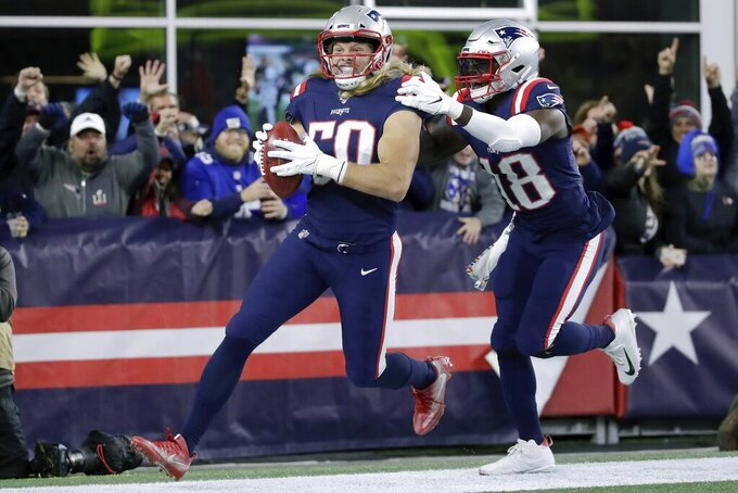 New England Patriots defensive end Chase Winovich, left, celebrates with Matthew Slater after running back a blocked punt by New York Giants punter Riley Dixon for a touchdown in the first half of an NFL football game, Thursday, Oct. 10, 2019, in Foxborough, Mass. (AP Photo/Elise Amendola)