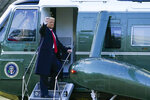 President Donald Trump gestures as he boards Marine One on the South Lawn of the White House, Wednesday, Jan. 20, 2021, in Washington. Trump is en route to his Mar-a-Lago Florida Resort. (AP Photo/Alex Brandon)
