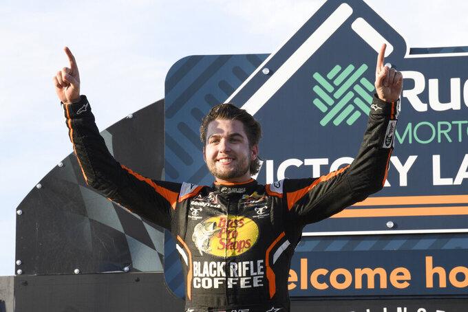 Noah Gragson celebrates in victory lane after winning a NASCAR Xfinity Series auto race Saturday, Sept. 4, 2021, in Darlington, S.C. (AP Photo/John Amis)
