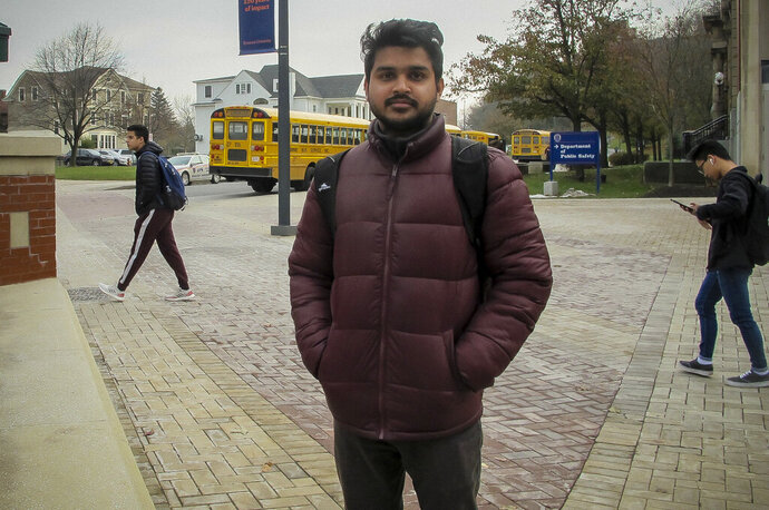 Ph.D. student Shiv Das, from India, stands on the campus of Syracuse University in Syracuse, New York, on Nov. 21, 2019. He said international students are already unnerved by the national fury around immigration, but numerous reports of racism targeting minority groups on campus feel even more personal. (AP Photo/Carolyn Thompson)