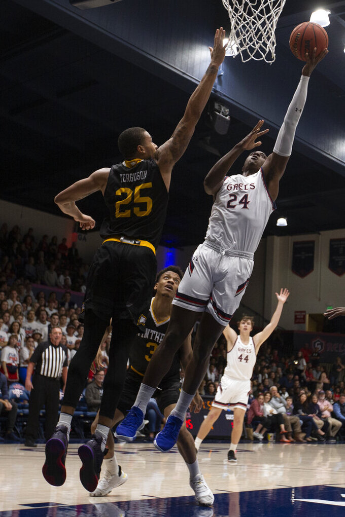 Saint Mary's forward Malik Fitts (24) puts up a shot over Winthrop forward Josh Ferguson (25) during the first half of an NCAA college basketball game, Monday, Nov. 11, 2019 in Moraga, Calif. (AP Photo/D. Ross Cameron)