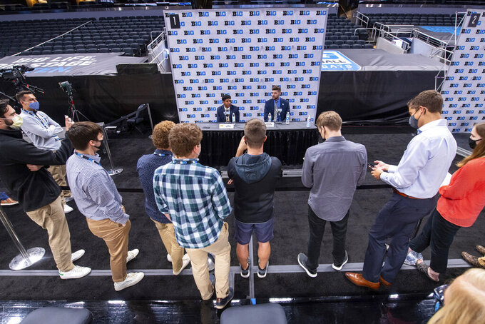 Michigan's Eli Brooks, left, and teammate Hunter Dickinson address the media during the first day of the Big Ten NCAA college basketball media days, Thursday, Oct. 7, 2021, in Indianapolis. (AP Photo/Doug McSchooler)