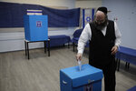 A man votes in Rosh Haayin, Israel, Tuesday, Sept. 17, 2019. Israelis began voting Tuesday in an unprecedented repeat election that will decide whether longtime Prime Minister Benjamin Netanyahu stays in power despite a looming indictment on corruption charges. (AP Photo/Sebastian Scheiner)