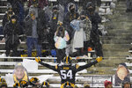 Iowa defensive tackle Daviyon Nixon (54) celebrates with fans in the stands at the end of an NCAA college football game against Wisconsin, Saturday, Dec. 12, 2020, in Iowa City, Iowa. Iowa won 28-7. (AP Photo/Charlie Neibergall)