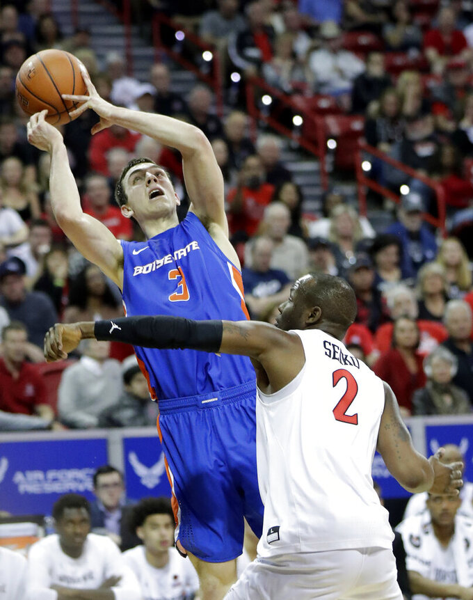 Boise State's Justinian Jessup (3) tries to shoot as San Diego State's Adam Seiko (2) defends during the first half of an NCAA college basketball game in the Mountain West Conference men's tournament Friday, March 6, 2020, in Las Vegas. (AP Photo/Isaac Brekken)