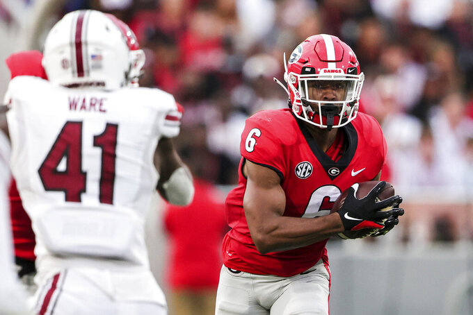 Georgia running back Kenny McIntosh (6) carries the ball against South Carolina during the first half of an NCAA college football game Saturday, Sept. 18, 2021, in Athens, Ga. (AP Photo/Butch Dill)
