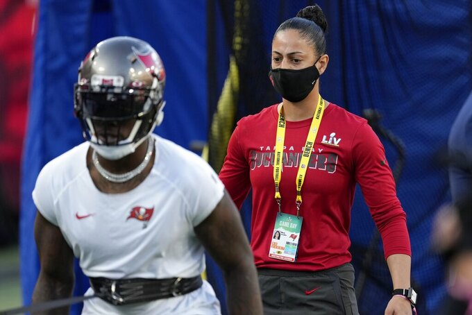 Tampa Bay Buccaneers strength and conditioning coach Maral Javadifar on the field before the NFL Super Bowl 55 football game between the Kansas City Chiefs and Buccaneers, Sunday, Feb. 7, 2021, in Tampa, Fla. (AP Photo/Chris O'Meara)