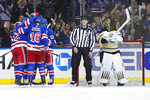 Boston Bruins goaltender Jaroslav Halak, right, reacts as the New York Rangers celebrate a goal by center Micheal Haley during the first period of an NHL hockey game, Sunday, Oct. 27, 2019, at Madison Square Garden in New York. (AP Photo/Mary Altaffer)