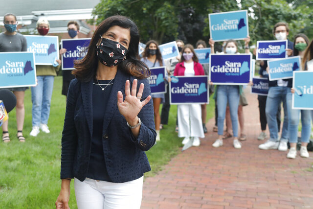 House Speaker Sara Gideon, D-Freeport, greets news media near a polling station, Tuesday, July 14, 2020, in Portland, Maine. Gideon is one of three Democrat candidates seeking the party's nomination for U.S. Senate in the July 14 primary. (AP Photo/Elise Amendola)