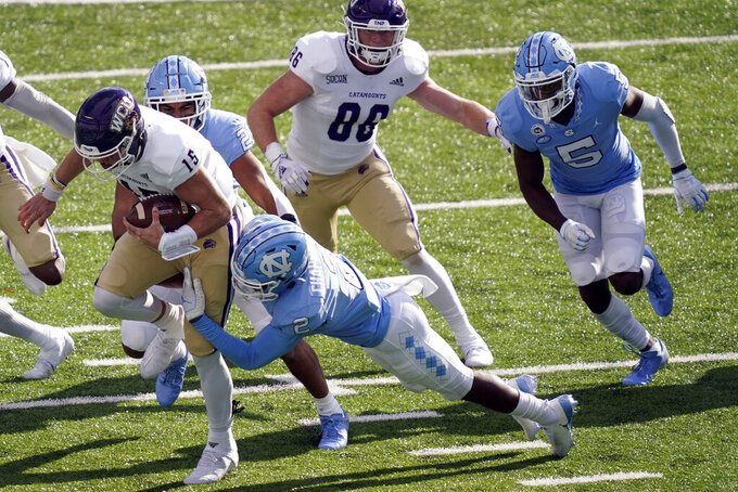 North Carolina defensive back Don Chapman (2) tackles Western Carolina quarterback Will Jones (15) during the first half of an NCAA college football game in Chapel Hill, N.C., Saturday, Dec. 5, 2020. (AP Photo/Gerry Broome)