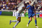 D.C. United forward Ola Kamara, left, scores a goal as Inter Miami defender Ryan Shawcross closes in during the second half of an MLS soccer match Saturday, May 29, 2021 in Fort Lauderdale, Fla. (AP Photo/Jim Rassol)