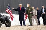 President Donald Trump tours a section of the U.S.-Mexico border wall under construction Tuesday, Jan. 12, 2021, in Alamo, Texas. (AP Photo/Alex Brandon)
