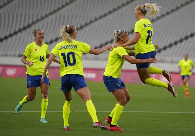 Sweden's Stina Blackstenius, right, celebrates scoring her side's opening goal against United States during a women's soccer match at the 2020 Summer Olympics, Wednesday, July 21, 2021, in Tokyo. (AP Photo/Ricardo Mazalan)