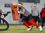 Ohio State outside guard Wyatt Davis runs through a drill during an NFL Pro Day at Ohio State University on Tuesday, March 30, 2021, in Columbus, Ohio. (AP Photo/Paul Vernon)