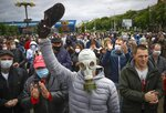 A man, wearing a mask to protect against coronavirus, attends a rally to support for potential presidential candidates in the upcoming presidential elections in Minsk, Belarus, Sunday, May 31, 2020. A human rights group in Belarus says more than 30 people have been detained amid demonstrations against authoritarian President Alexander Lukashenko running for another term. The presidential campaign is underway in Belarus despite the coronavirus outbreak after the parliament and government refused to postpone the election scheduled for August 9. (AP Photo/Sergei Grits)