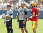 Green Bay Packers quarterback Aaron Rodgers and New York Jets head coach Robert Saleh and offensive coordinator Mike LaFleur (left) share a laugh during a joint NFL football training camp practice Wednesday, Aug. 18, 2021, in Green Bay, Wis. (AP Photo/Matt Ludtke)
