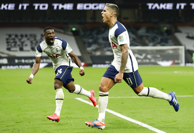 Tottenham's Erik Lamela, right, celebrates after scoring his team's first goal with teammate Serge Aurier during the English League Cup fourth round soccer match between Tottenham Hotspur and Chelsea at Tottenham Hotspur Stadium in London, England, Tuesday, Sept. 29, 2020.(Matt Dunham/Pool via AP)