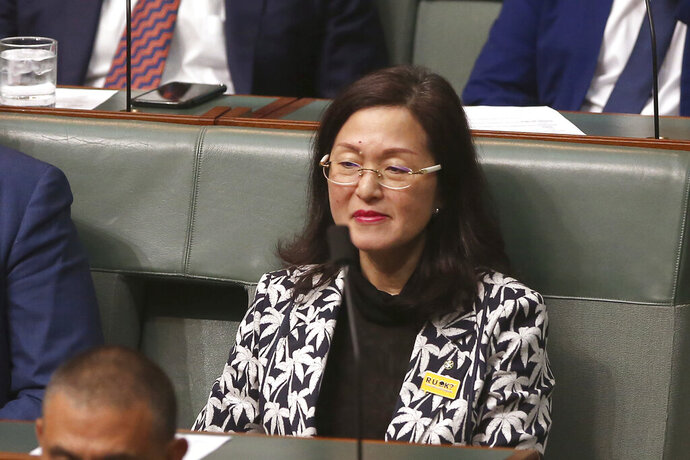 In this Sept. 12, 2019, photo, government lawmaker Gladys Liu sits in Parliament House in Canberra, Australia. Lawyers for Liu, the first Chinese-born lawmaker to be appointed to Australia's Parliament, and for a senior government minister have appeared in a court to fight challenges to their elections over misleading Chinese-language campaign signs. (AP Photo/Rod McGuirk)