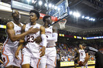 Auburn center Austin Wiley (50) and forward Danjel Purifoy (3) help forward Isaac Okoro (23) off the floor after a collision with a Furman player under the basket during overtime of an NCAA college basketball game Thursday, Dec. 5, 2019, in Auburn, Ala. (AP Photo/Julie Bennett)