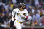 San Diego Padres' Fernando Tatis Jr. watches his solo home run off Cincinnati Reds starting pitcher Wade Miley during the sixth inning of a baseball game Thursday, June 17, 2021, in San Diego. (AP Photo/Derrick Tuskan)