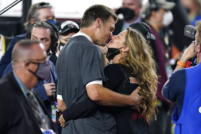 Tampa Bay Buccaneers quarterback Tom Brady kisses wife Gisele Bundchen after defeating the Kansas City Chiefs in the NFL Super Bowl 55 football game Sunday, Feb. 7, 2021, in Tampa, Fla. The Buccaneers defeated the Chiefs 31-9 to win the Super Bowl. (AP Photo/Mark Humphrey)