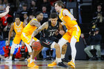 Cincinnati's Jarron Cumberland (34) dribbles against Tennessee's John Fulkerson (10) during the first half of an NCAA college basketball game, Wednesday, Dec. 18, 2019, in Cincinnati. (AP Photo/John Minchillo)