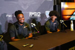 Oregon State linebacker Avery Roberts, left, and defensive back Jaydon Grant field questions during the Pac-12 Conference NCAA college football Media Day Tuesday, July 27, 2021, in Los Angeles. (AP Photo/Marcio Jose Sanchez)
