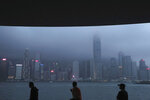People sit on the waterfront of the Victoria Harbor of Hong Kong Thursday, May 28, 2020. Hong Kong has been living on borrowed time ever since the British made it a colony nearly 180 years ago, and all the more so after Beijing took control in 1997, granting it autonomous status. A national security law approved by China's legislature Thursday is a reminder that the city's special status is in the hands of Communist Party leaders who have spent decades building their own trade and financial centers to take Hong Kong's place. (AP Photo/Kin Cheung)