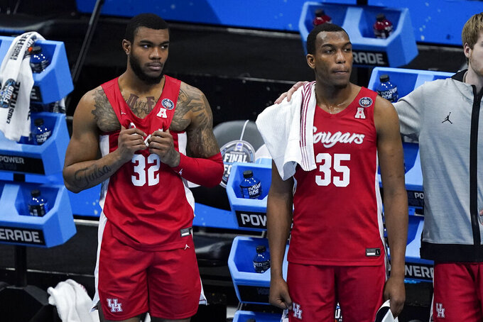 Houston forward Reggie Chaney (32) and forward Fabian White Jr. (35) watch the end of a men's Final Four NCAA college basketball tournament semifinal game against Baylor, Saturday, April 3, 2021, at Lucas Oil Stadium in Indianapolis. Baylor won 78-59. (AP Photo/Darron Cummings)