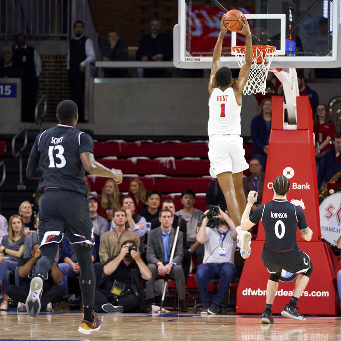 SMU forward Feron Hunt (1) dunks the ball against Cincinnati during the first half of an NCAA college basketball game at Moody Coliseum, Wednesday, Feb. 27, 2019, in Dallas. (AP Photo/Cooper Neill)
