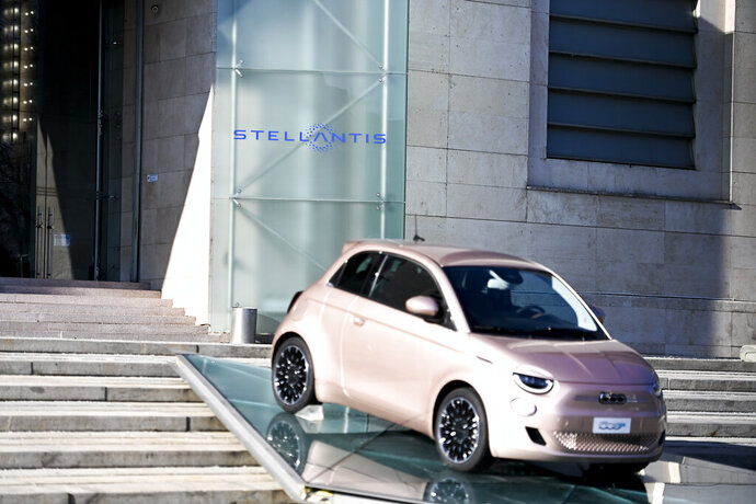 The new Stellantis logo was added on the side of the other logos of the group, on the day of the stock market debut, at the historic Mirafiori headquarters in Turin, Italy, Monday, Jan. 18, 2021. Stellantis, the car company combining PSA Peugeot and Fiat Chrysler, was launched Monday on the Milan and Paris stock exchanges, giving life to the fourth-largest car company in the world. (Marco Alpozzi/LaPresse via AP)