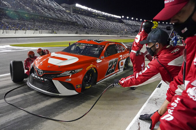 Bubba Wallace makes a pit stop during the second of two qualifying auto races for the NASCAR Daytona 500 at Daytona International Speedway, Thursday, Feb. 11, 2021, in Daytona Beach, Fla. Wallace finished in second place. (AP Photo/John Raoux)