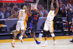 Florida's Tyree Appleby (22) goes to the basket against Tennessee's Jaden Springer (11) and Yves Pons (35) during an NCAA college basketball game Sunday, March 7, 2021, in Knoxville, Tenn. (Randy Sartin/Pool Photo via AP)