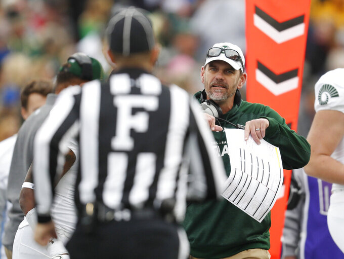 FILE - In this Thursday, No. 22, 2018, file photo, Colorado State head coach Mike Bobo, back, argues with field judge Rich Almeroth in the first half of an NCAA college football game against Air Force at Air Force Academy, Colo. Bobo will lead his Rams into their first gameof the new NCAA season when they travel to Denver to face intrastate rival Colorado. (AP Photo/David Zalubowski, File)