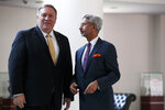 U.S. Secretary of State Mike Pompeo listens to Indian Foreign Minister Subrahmanyam Jaishankar as he arrives for their meeting at the Foreign Ministry in New Delhi, India, Wednesday, June 26, 2019. Pompeo held meetings in India's capital on Wednesday amid growing tensions over trade and tariffs that has strained the partners' ties. (AP Photo/Jacquelyn Martin, Pool)
