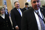 U.S. Secretary of State Mike Pompeo, second left, arrives to a NATO Foreign Ministers meeting at the NATO headquarters in Brussels, Wednesday, Nov. 20, 2019. (AP Photo/Francisco Seco, Pool)