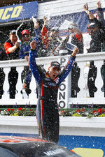 Ty Majeski celebrates after winning the ARCA Series auto race at Pocono Raceway, Friday, May 31, 2019, in Long Pond, Pa. (AP Photo/Matt Slocum)