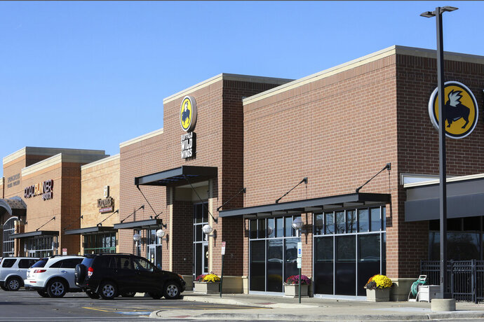 FILE - This Nov. 5, 2019, file photo shows the Buffalo Wild Wings restaurant in Naperville, Ill., a suburb of Chicago. Police investigating an incident at the Chicago-area restaurant found no indication that workers ever heard a white patron mention the race of a group of black customers when he asked that they not be seated next to him. The police report obtained by the (Arlington Heights) Daily Herald said the white customer had racist views that were well known to the restaurant's employees, but that the man denied saying anything racist during the Oct. 26 incident in Naperville.  (AP Photo/Teresa Crawford, File)