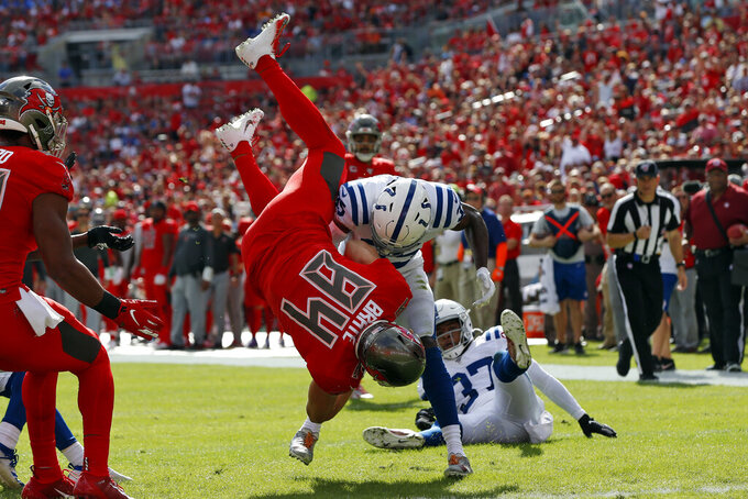 Indianapolis Colts cornerback Pierre Desir (35) upends Tampa Bay Buccaneers tight end Cameron Brate (84) after a reception during the first half of an NFL football game Sunday, Dec. 8, 2019, in Tampa, Fla. (AP Photo/Mark LoMoglio)