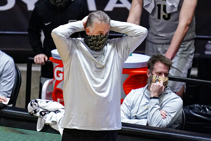 Purdue coach Matt Painter watches his team play against Michigan during the second half of an NCAA college basketball game in West Lafayette, Ind., Friday, Jan. 22, 2021. Michigan won 70-53. (AP Photo/Michael Conroy)