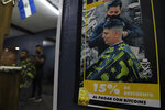 A poster inside Barber Shop announces discounts to those who pay with Bitcoin cryptocurrency in Santa Tecla, El Salvador, Saturday, Sept. 4, 2021. Starting Tuesday, Sept. 7, all businesses will have to accept payments in Bitcoin, except those lacking the technology to do so. (AP Photo/Salvador Melendez)