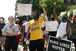 Protesters demonstrate outside the City Justice Center Monday, June 1, 2020, in St. Louis. Protesters gathered to speak out against the death of George Floyd who died after being restrained by Minneapolis police officers on May 25. (AP Photo/Jeff Roberson)