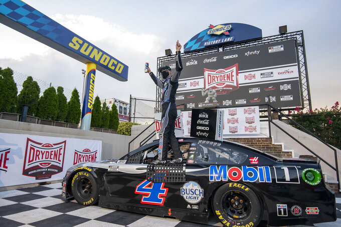 Kevin Harvick (4) celebrates after winning a NASCAR Cup Series auto race at Dover International Speedway, Sunday, Aug. 23, 2020, in Dover, Del. (AP Photo/Jason Minto)