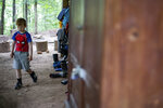 Felix Johnson plays hide and seek during the Wauhatchie School forest day camp at Reflection Riding Arboretum and Nature Center on Thursday, July 1, 2021 in Chattanooga, Tenn. (Troy Stolt/Chattanooga Times Free Press via AP)