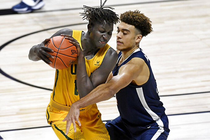 San Francisco's Josh Kunen, left, is guarded by Virginia's Justin McKoy, right, in the second half of an NCAA college basketball game, Friday, Nov. 27, 2020, in Uncasville, Conn. (AP Photo/Jessica Hill)