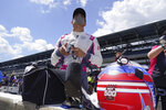 Alex Palou, of Spain, looks at his qualification results for the Indianapolis 500 auto race at Indianapolis Motor Speedway, Sunday, Aug. 16, 2020, in Indianapolis. (AP Photo/Darron Cummings)