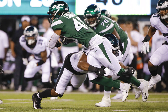 Philadelphia Eagles' Chris Worley (52) tackles New York Jets' Trenton Cannon (40) during the first half of a preseason NFL football game Thursday, Aug. 29, 2019, in East Rutherford, N.J. (AP Photo/Matt Rourke)